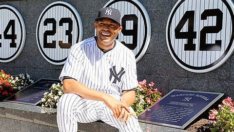 Mariano Rivera #42 of the New York Yankees poses next to his retired number in Monument Park