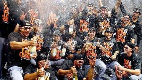 Detroit Tigers players celebrate amidst a rain of alcohol-free sparkling wine