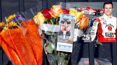 Momentos, photos and tickets are among items left at a memorial at the main gate at the Indianapolis Motor Speedway