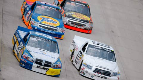 Todd Bodine (11) races against Parker Kligerman (29), Kevin Harvick (2) and Ty Dillon (3)