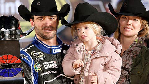Jimmie Johnson, driver of the #48 Lowe's Chevrolet, celebrates in Victory Lane with his wife Chandra and daughter Genevieve Marie