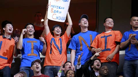 Fans cheer for New York Knicks point guard Jeremy Lin