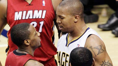 David West & Mario Chalmers (AP Photo/Michael Conroy)