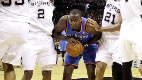 San Antonio Spurs' Boris Diaw (33), Kawhi Leonard (2), Tim Duncan (21) and Danny Green (4) pressure Oklahoma City Thunder center Kendrick Perkins (5)