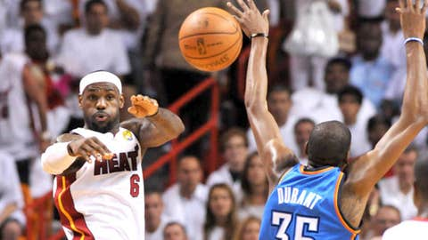 Miami Heat small forward LeBron James (6) passes against Oklahoma City Thunder small forward Kevin Durant (35)