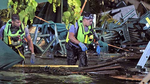 Rescue divers search for missing persons after a packed outdoor deck collapsed at popular Miami-area sports bar Thursday June 13, 2013