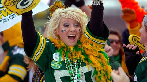 Green Bay Packers fan Lacy Winchell high-fives other fans