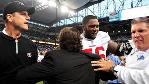 San Francisco 49ers head coach Jim Harbaugh (left) fights with Detroit Lions head coach Jim Schwartz