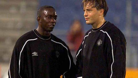 Dwight Yorke and Mark Bosnich
