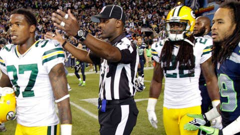Image: Referee gestures after Packers-Seahawks game (© Ted S. Warren/AP Photo)