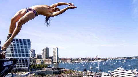 Orlando Duque of Colombia dives from the 27.5 metre platform
