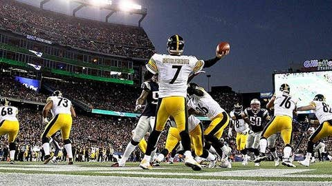 Ben Roethlisberger #7 of the Pittsburgh Steelers drops back to pass in the endzone against the New England Patriots