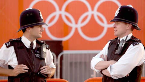 Police officers stand guard inside the Olympic Park in London