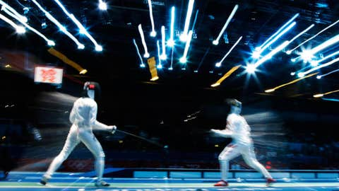 Russia's Lyubov Shutova, left, competes with China's Luo Xiaojuan