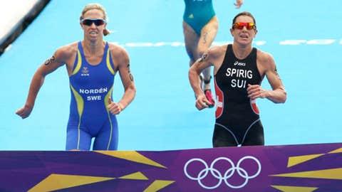 Gold-medallist Switzerland's Nicola Spirig, right, silver-medallist Sweden's Lisa Norden, left, and bronze-medallist Australia's Erin Densham compete