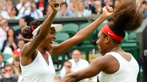 Venus Williams (USA), left, and Serena Williams (USA), right, celebrate after recording match point to win the gold medal in the doubles competition a