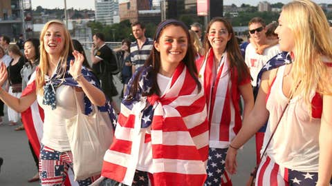 United States fans cheer as they walk towards Wembley Stadium