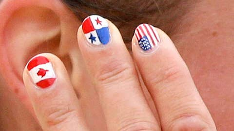 Painted fingernails decorate the hands of Lena Schoneborn, of Germany