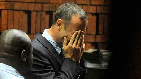 Athlete Oscar Pistorius weeps in court in Pretoria, South Africa, Friday, Feb 15, 2013, at his bail hearing in the murder case of his girlfriend Reeva