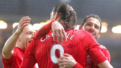Liverpool's Maxi Rodriguez, right, celebrates with teammates