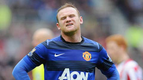 Wayne Rooney of Manchester United looks dejected