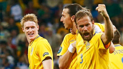 Sweden's Olof Mellberg (R) celebrates
