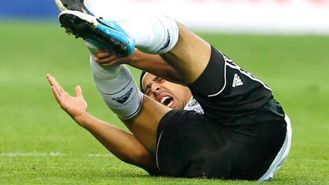 Germany's Sami Khedira grimaces in pain