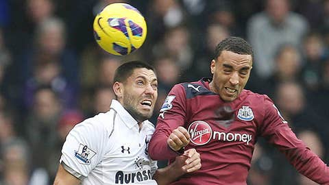 Tottenham's Clint Dempsey (L) and Newcastle's James Perch in action