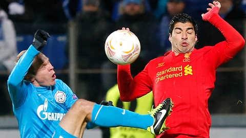 Liverpool's Luis Suarez, right, in action against Zenit's Aleksandr Anyukov