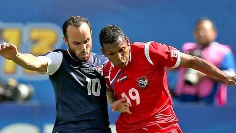 Landon Donovan #10 of the United States battles with Alberto Quintero #19 of Panama