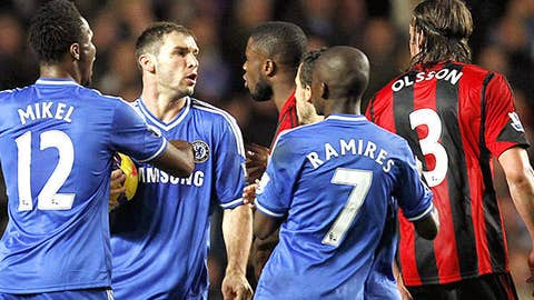 West Bromwich Albion's Swedish defender Jonas Olsson (R) and Chelsea's Serbian defender Branislav Ivanovic (2nd L) confront each other
