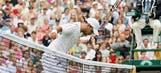 Federer survives Wimbledon scare