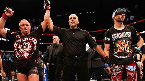 Image: Georges St-Pierre (L) reacts after winning (© Josh Hedges/Zuffa LLC via Getty Images)