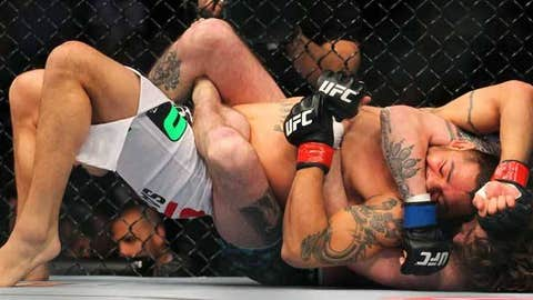 Leonard Garcia (white shorts) competes against Cody McKenzie
