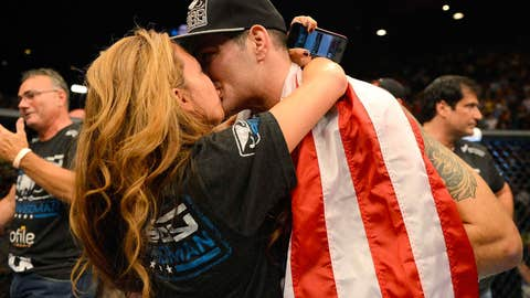 Chris Weidman embracing his wife after his landmark victory