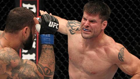 Image: (From left) UFC fighter Alessio Sakara punched by Brian Stann (© Josh Hedges / Zuffa LLC via Getty Images)