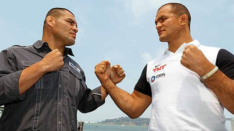 Cain Velasquez (L) and Junior dos Santos (R) square off during a UFC press tour event on July 29, 2013 in San Francisco, California.
