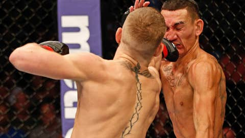 Conor McGregor lands a straight right against Max Holloway