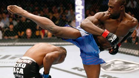 Photo Of The Year? Uriah Hall and John Howard swing and miss.