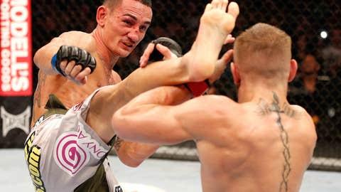 Max Holloway head kicks Conor McGregor