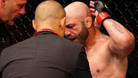 Manny Gamburyan argues for an illegal elbow