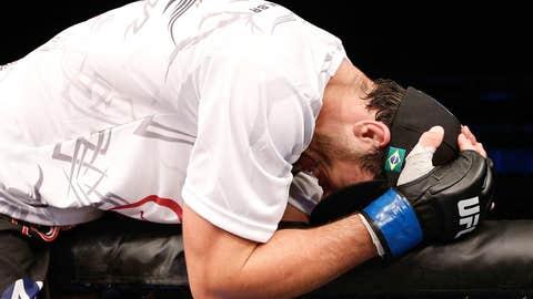 An emotional Elias Silverio celebrating atop the Octagon
