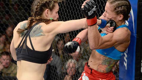 Davis connecting a fist to Carmouche's face