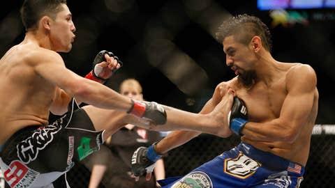 Erik Perez kicks Edwin Figueroa