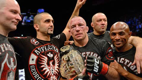 Georges St-Pierre (C) celebrates with his teammates