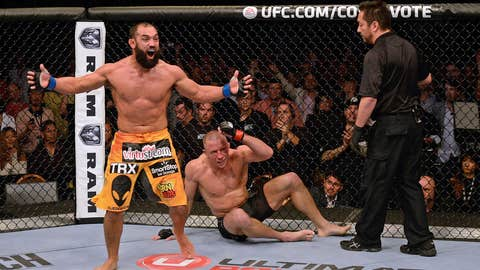 Johny Hendricks (L) reacts after the end of his fight with Georges St-Pierre