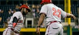 Phillips homers, Reds hold on to beat Buccos 4-3