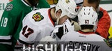 Ouch! Blackhawks' Scuderi takes slap shot to face