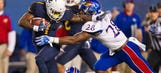 No. 14 West Virginia hands Kansas 40th straight road loss
