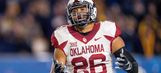 Oklahoma LB Evans grows after rough film session with dad